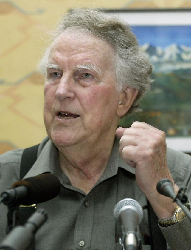 Sir Edmund Hillary gestures as he answer